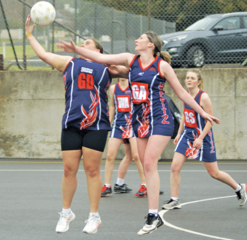 GD Amarley Wilson and Hobitz Blue GA Emily Stockwell battle for the ball